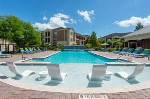 Apartments for Rent in Katy, TX - Pool with Tanning Shelf, Patio with Lounge Chairs